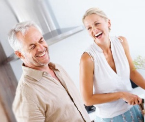 couple in kitchen laughing