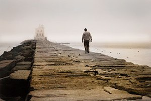 Lighthouse_Man_Alone_300px