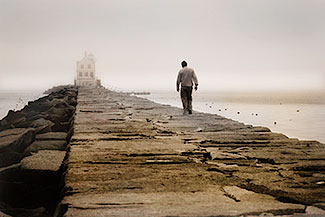Lighthouse_Man_Alone_300px