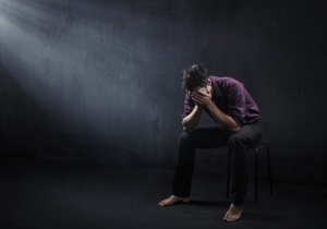 stockfresh_735852_sad-man-in-a-empty-room_sizeXS