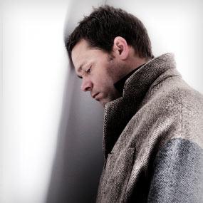 slide08-sad-contemplating-man