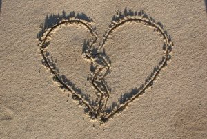 4294111-shape-of-broken-heart-on-sand